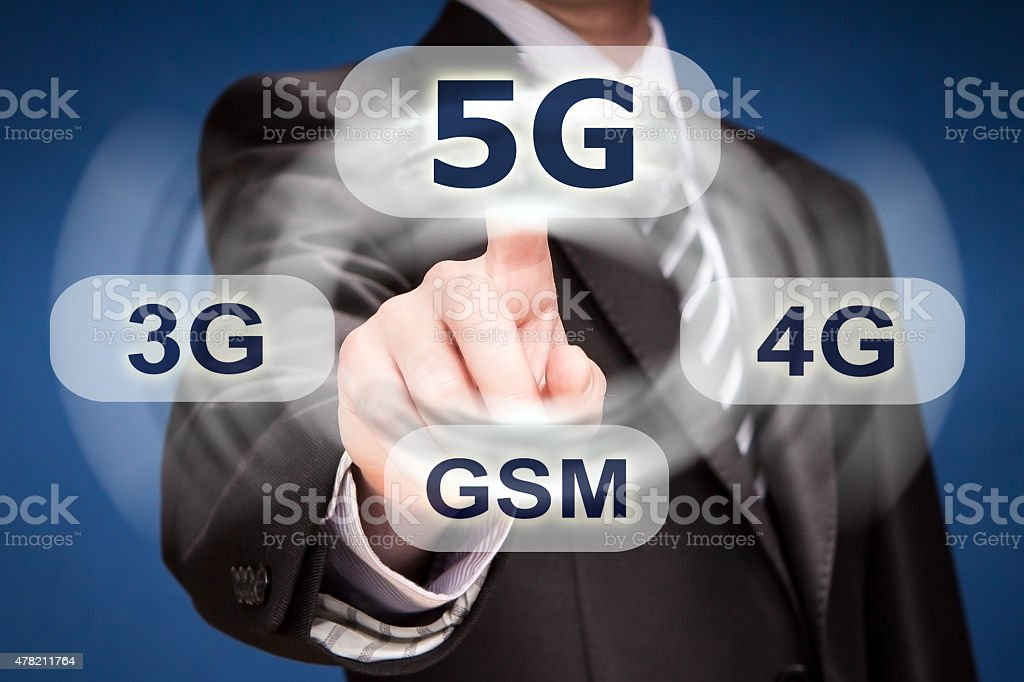 Businessman pushing finger on 5g button stock photo
