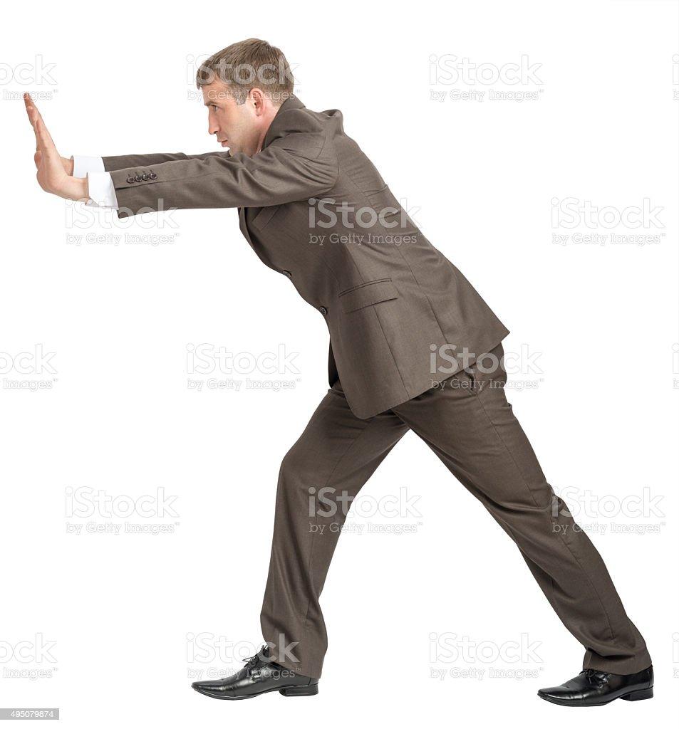Businessman pushing forward stock photo