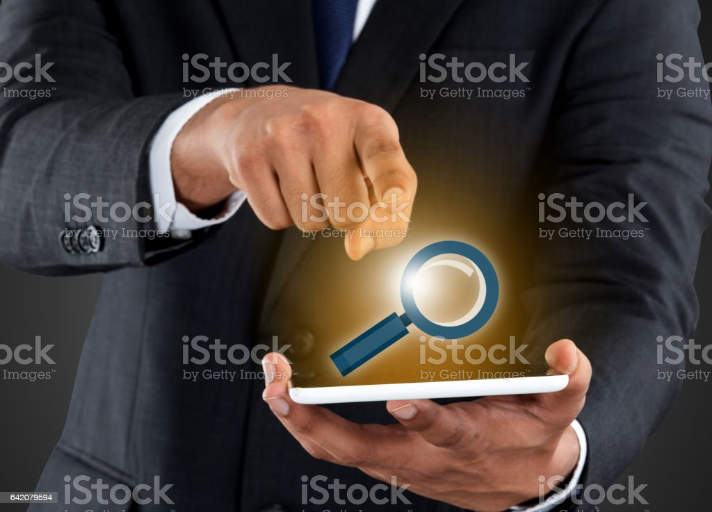 Businessman pushing magnifying virtual button stock photo