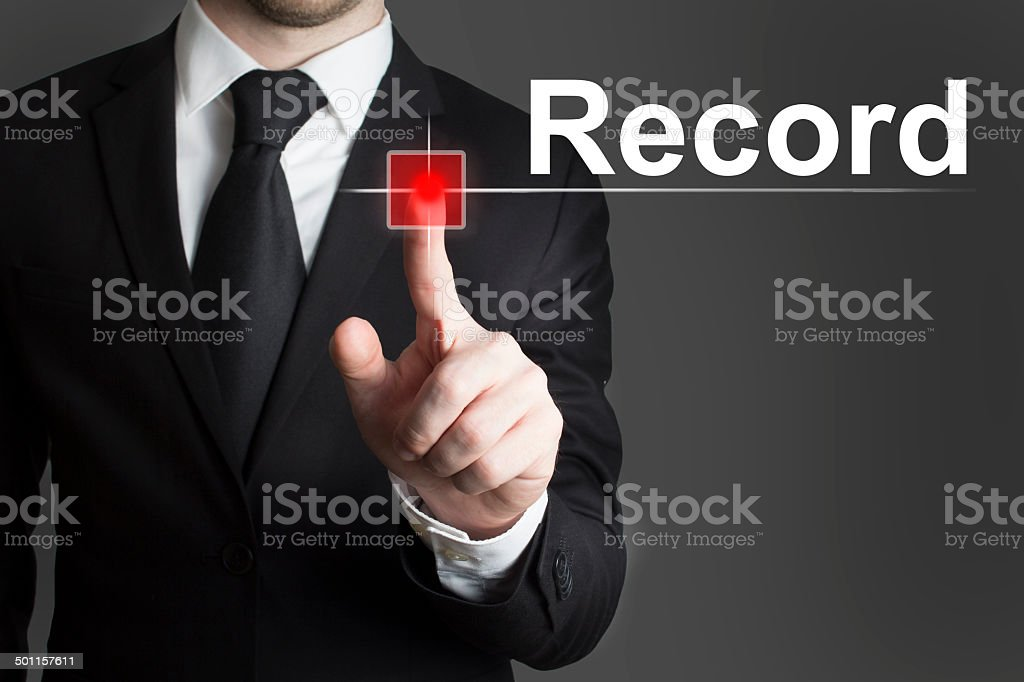 businessman pushing red button record stock photo
