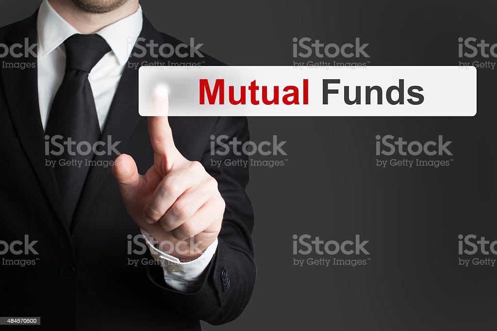 businessman pushing touchscreen button mutual funds stock photo