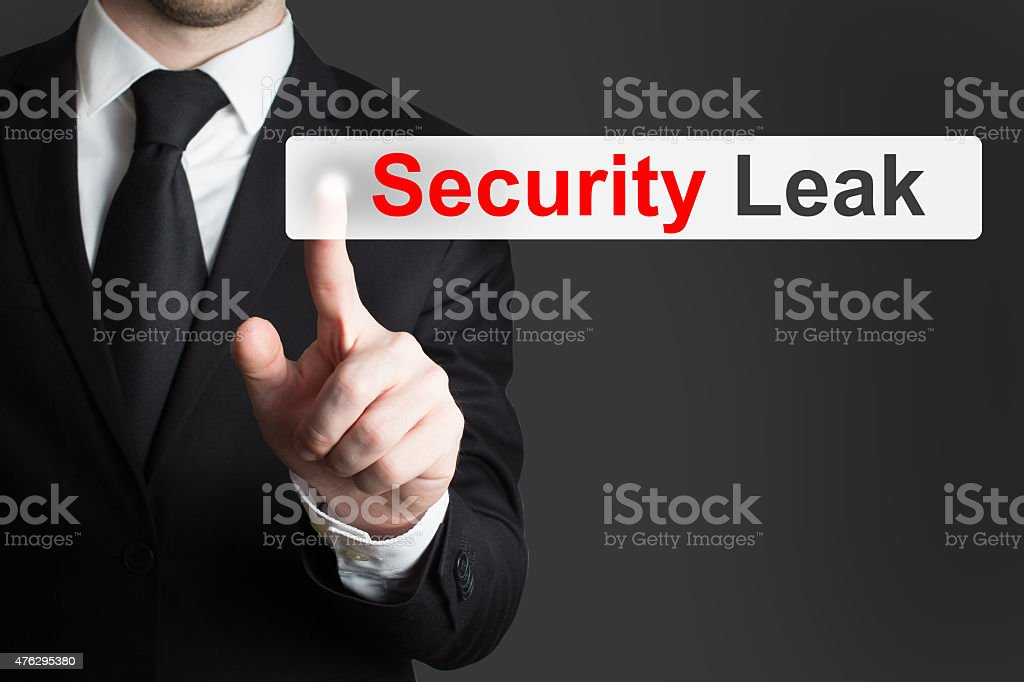 businessman pushing touchscreen security leak stock photo