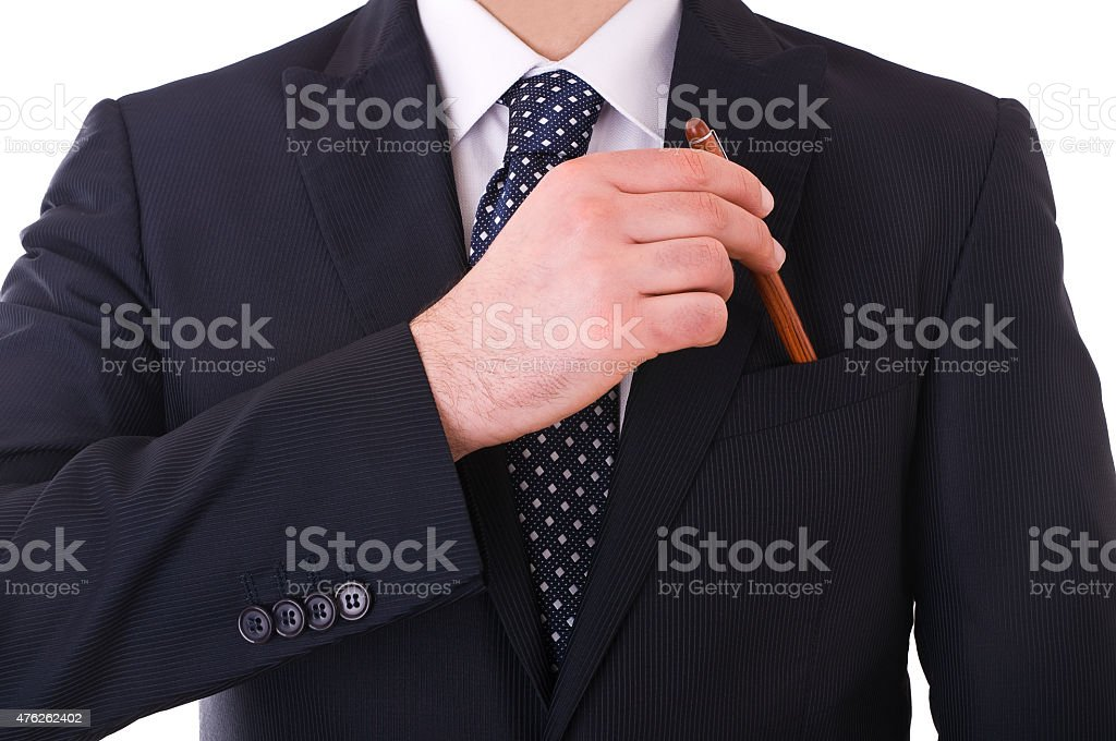 Businessman putting a pen in his pocket. stock photo