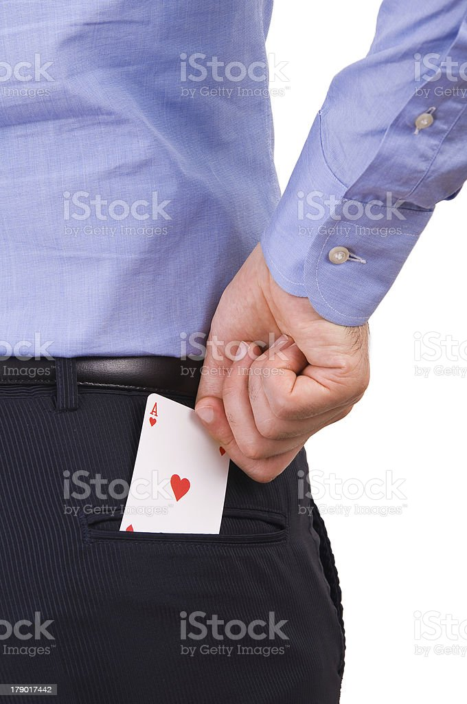 Businessman putting ace card in back pocket. royalty-free stock photo