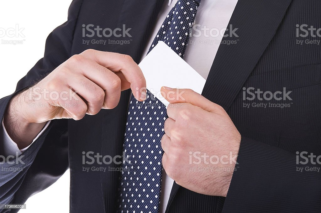 Businessman putting blank card in his pocket. royalty-free stock photo