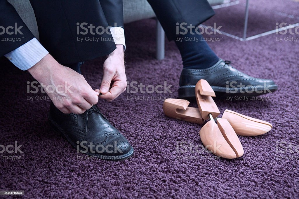 businessman putting his shoes on stock photo