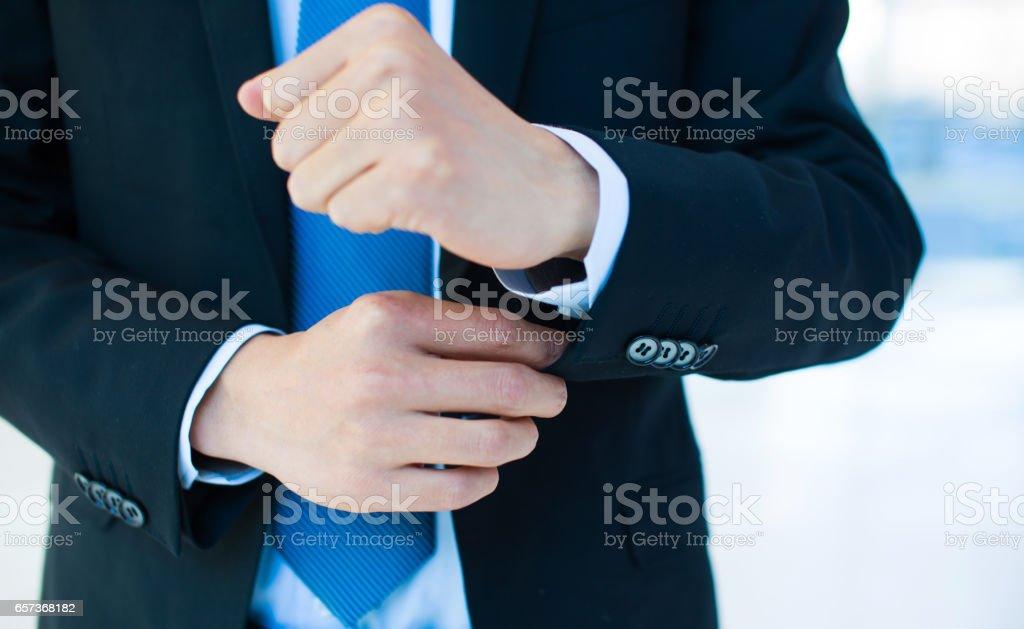Businessman putting his suit stock photo