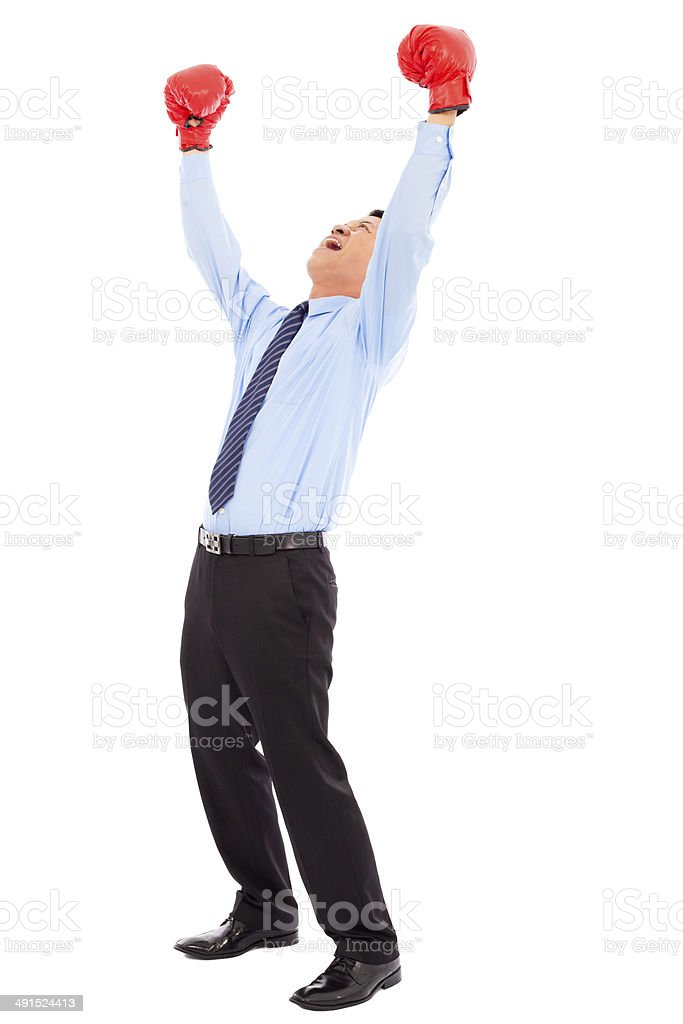 businessman raise arms up to win the competition stock photo