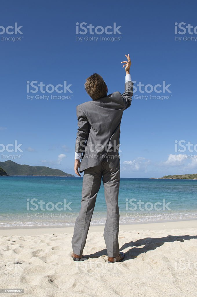 Businessman Raises One Hand to the Sky royalty-free stock photo