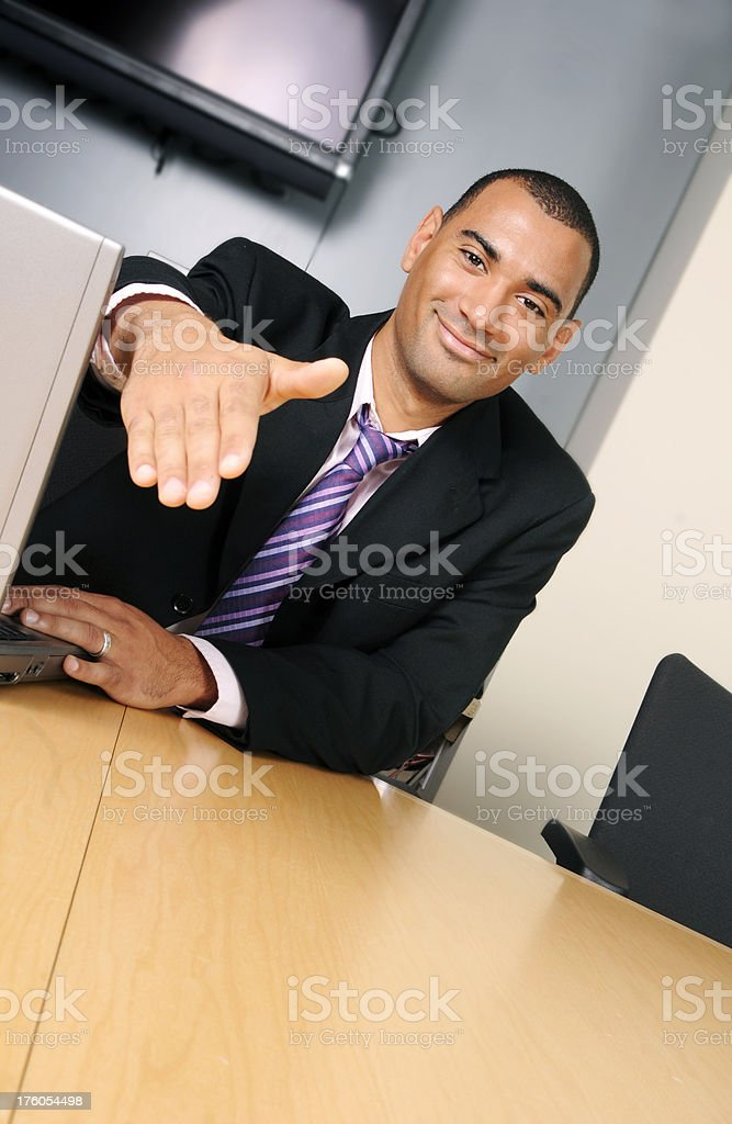 Businessman Reaching Out for a Handshake royalty-free stock photo