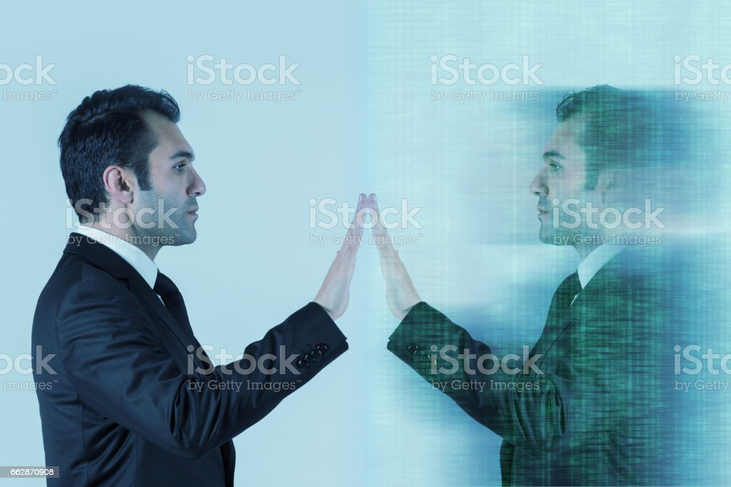 Businessman reaching out to self stock photo