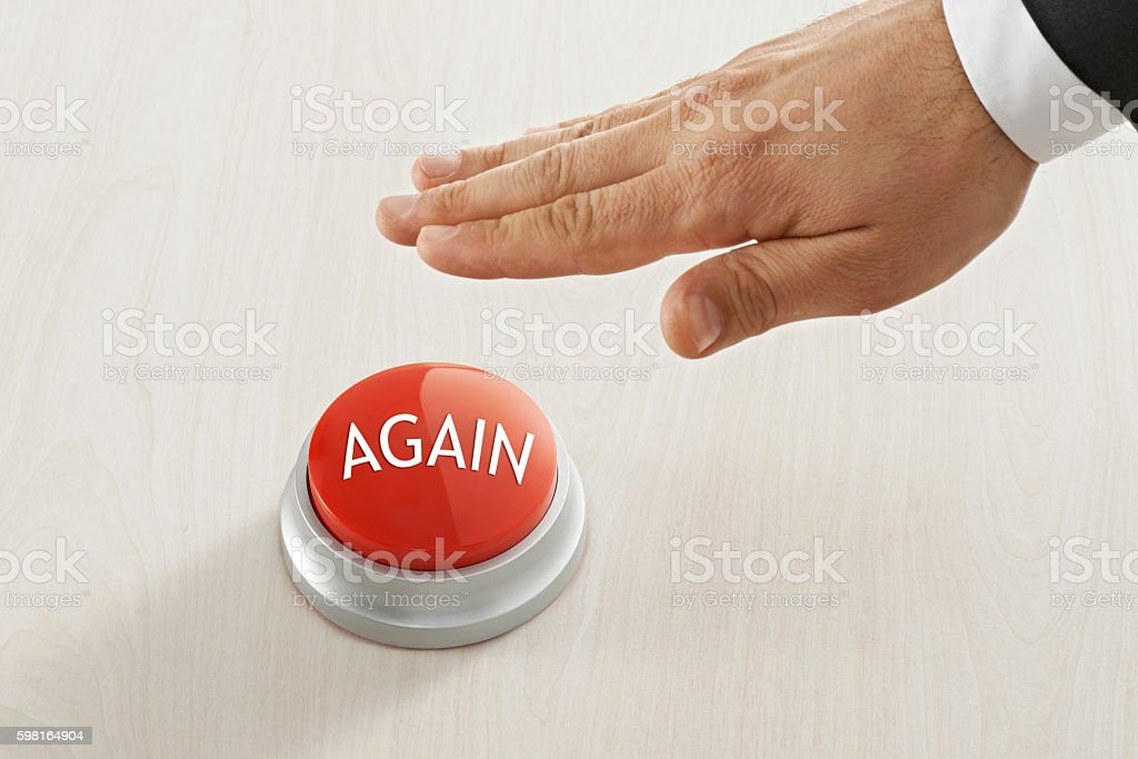 Businessman Reaching to 'again ' button stock photo