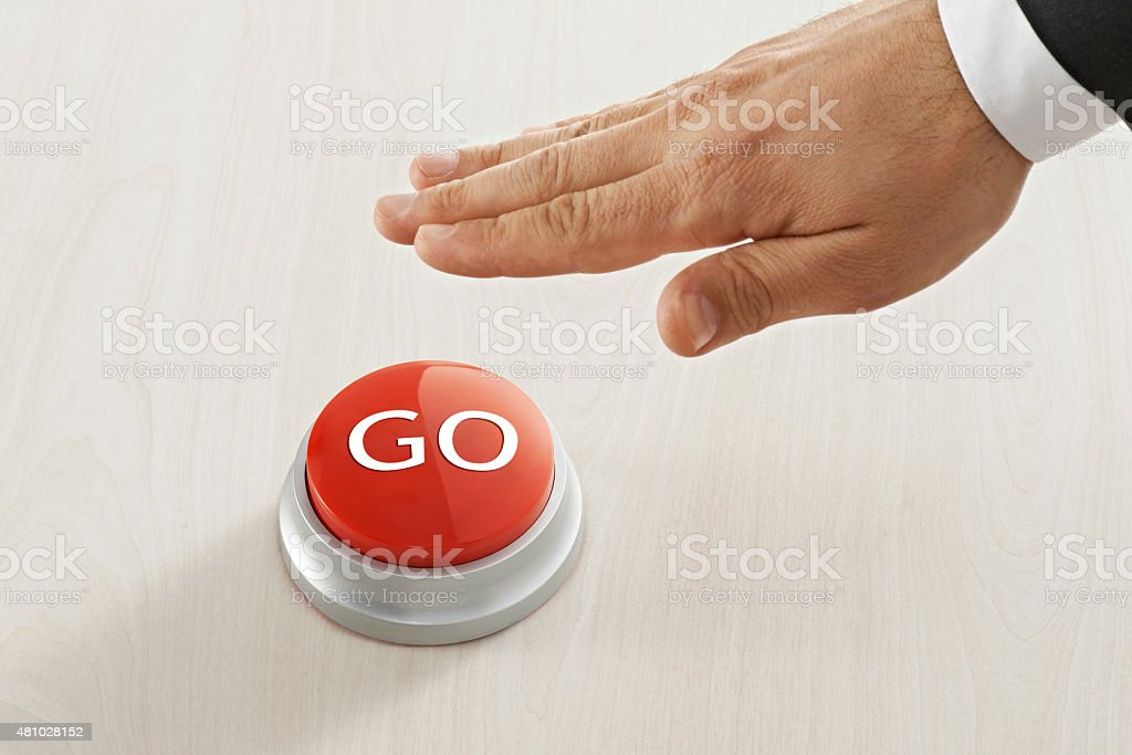 Businessman Reaching to go ' button stock photo