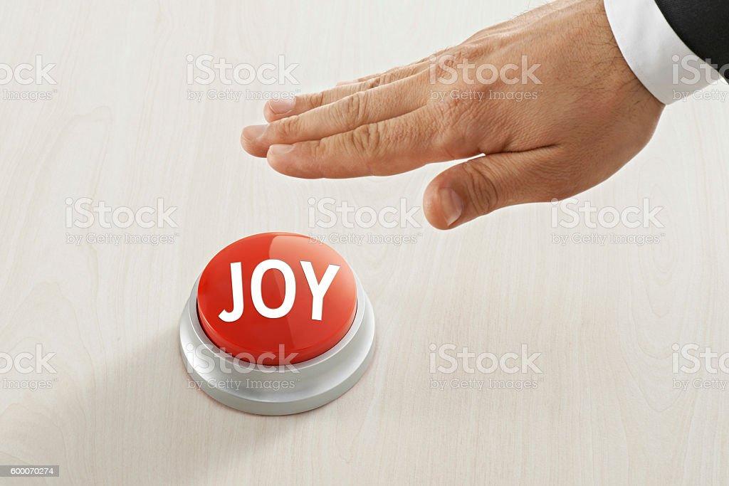 Businessman Reaching to 'joy ' button stock photo