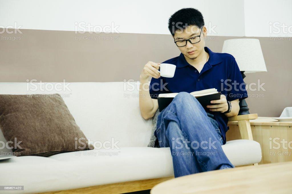 Businessman read notebook indoors stock photo