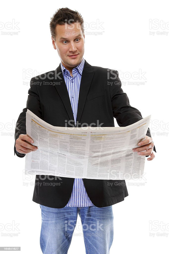 Businessman reading a newspaper isolated royalty-free stock photo