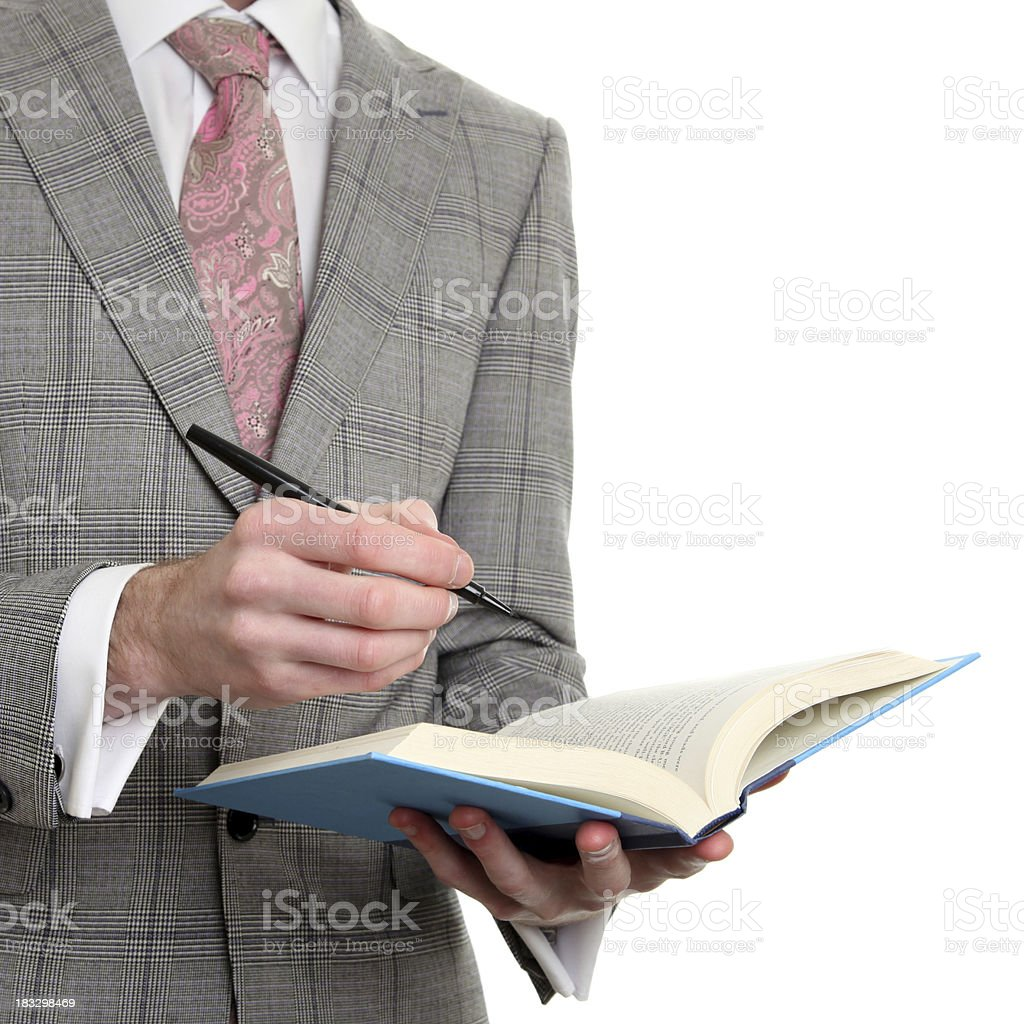 Businessman reading and taking notes royalty-free stock photo