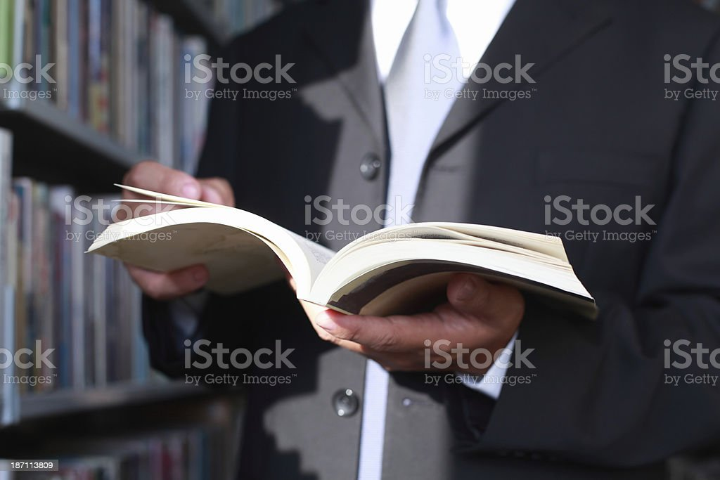 Businessman Reading Book in Library royalty-free stock photo