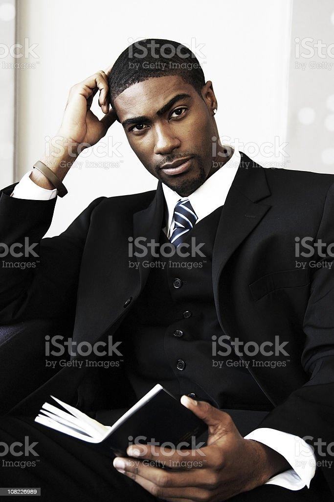 Businessman Reading Book stock photo