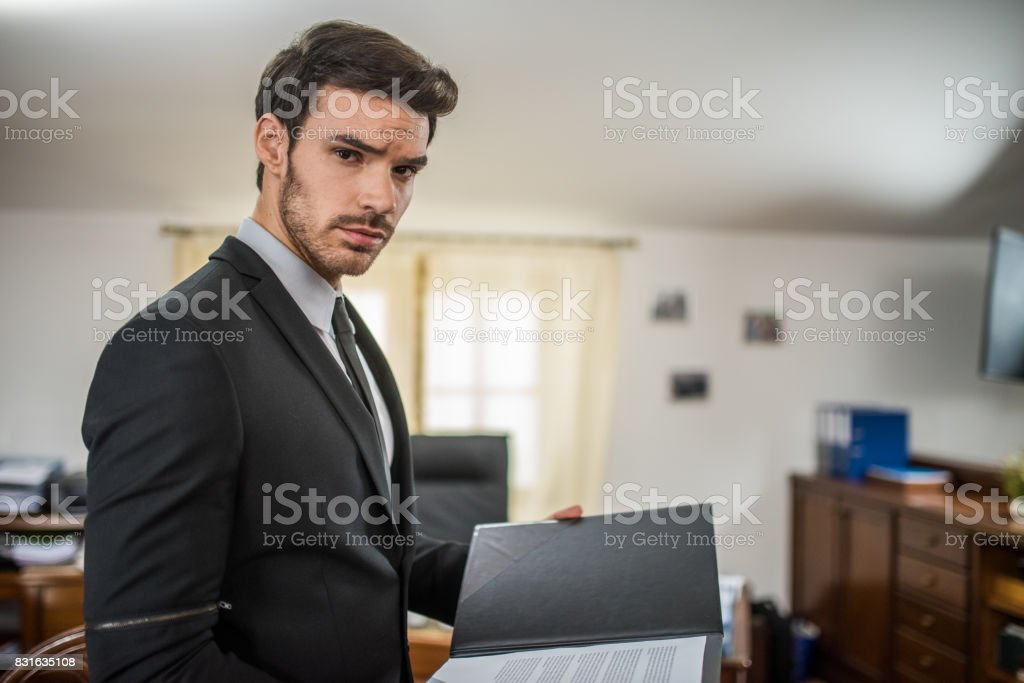 Businessman reading documents stock photo