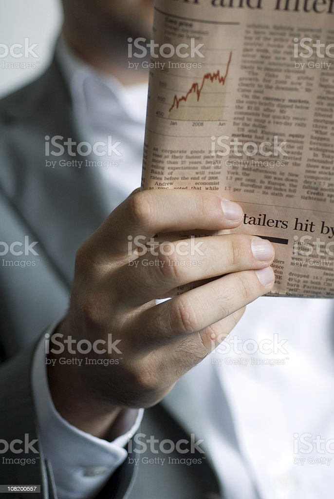 Businessman Reading Financial Newspaper royalty-free stock photo