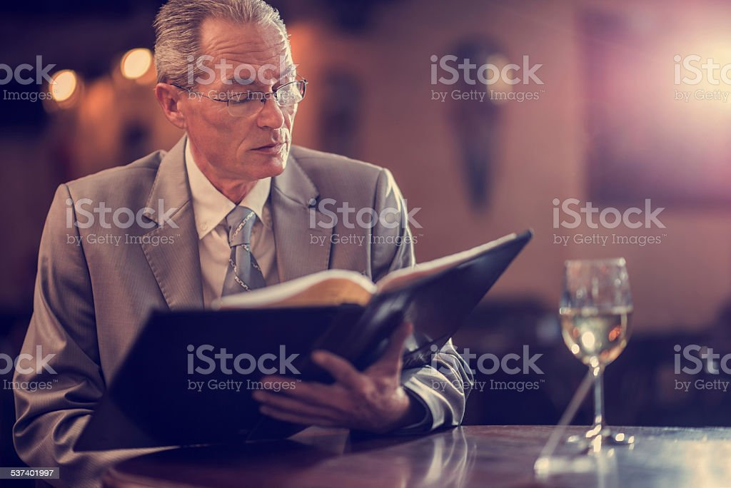 Businessman reading menu. stock photo