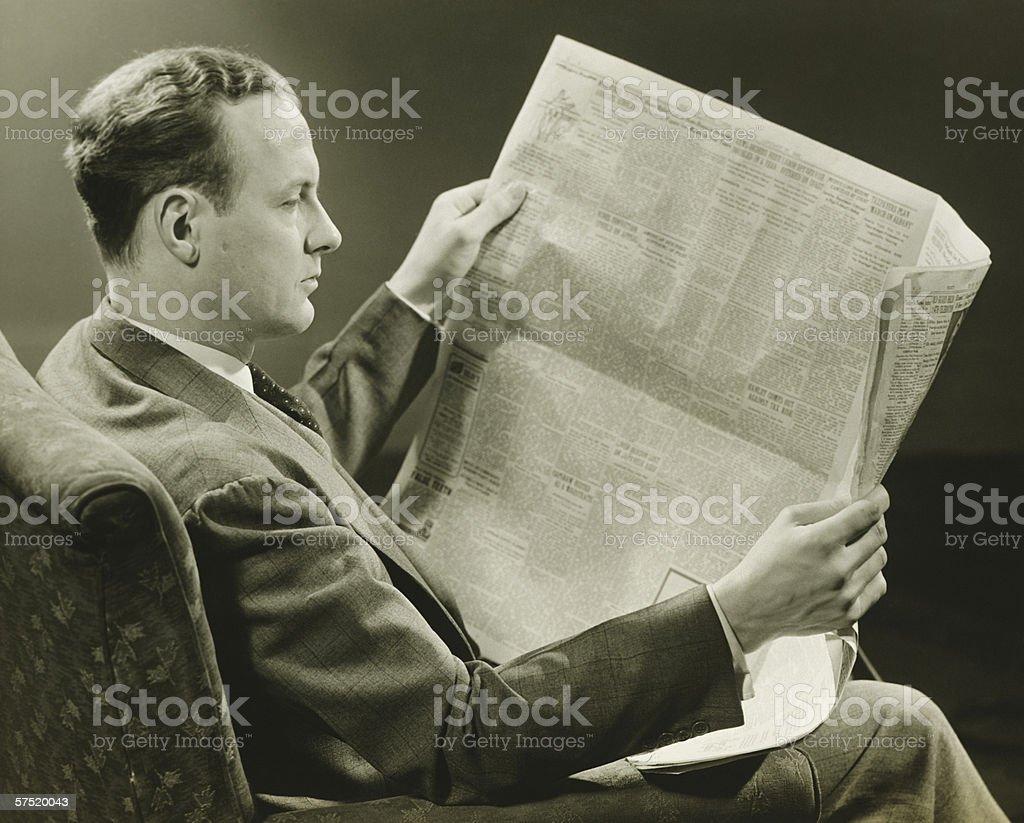 Businessman reading newspaper, (B&W) royalty-free stock photo