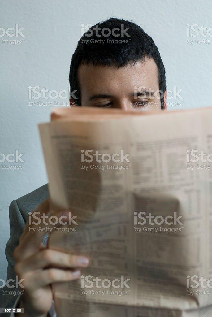 Businessman reading newspaper royalty-free stock photo