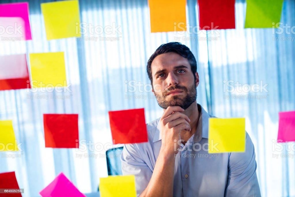 Businessman reading post it royalty-free stock photo