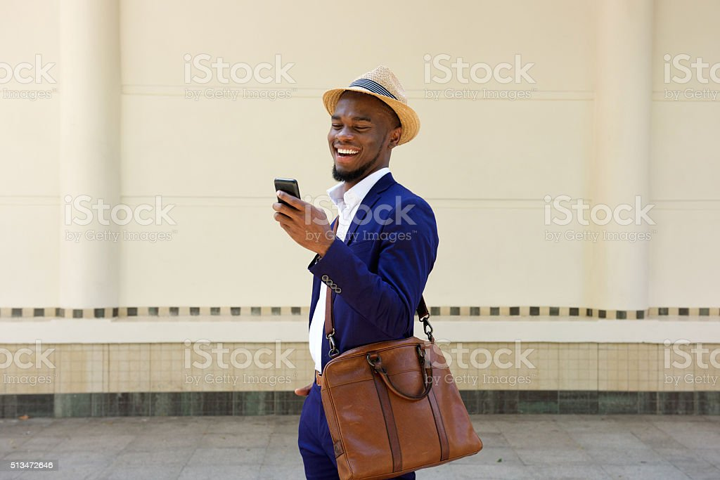 Businessman reading text message on mobile phone stock photo