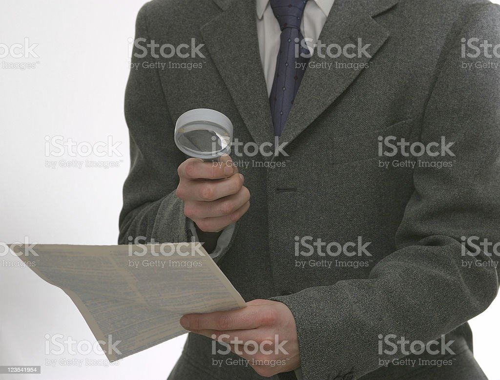 Businessman reading the small text royalty-free stock photo