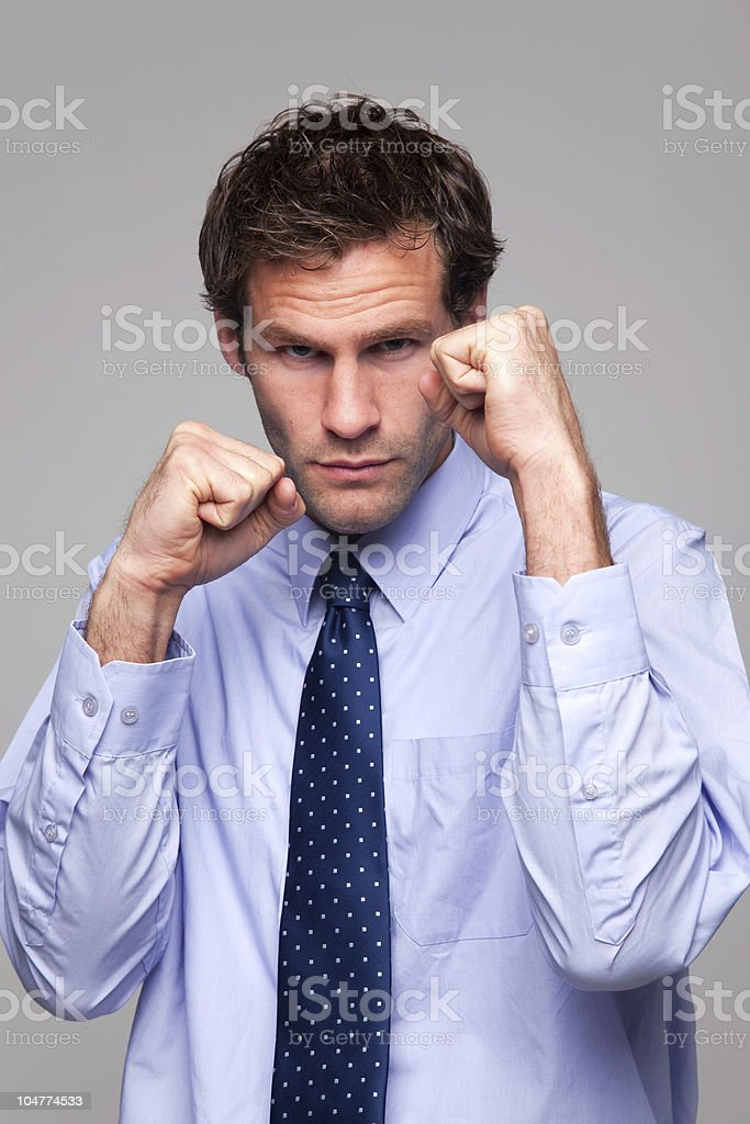 Businessman ready to do battle stock photo