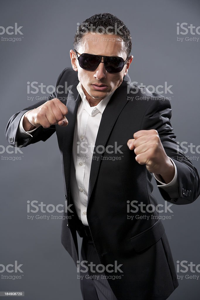 Businessman ready to fight or box stock photo