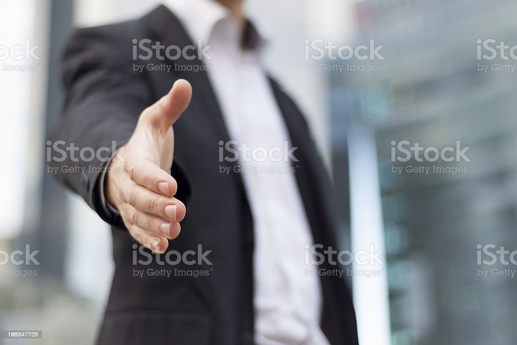 Businessman ready to handshake stock photo
