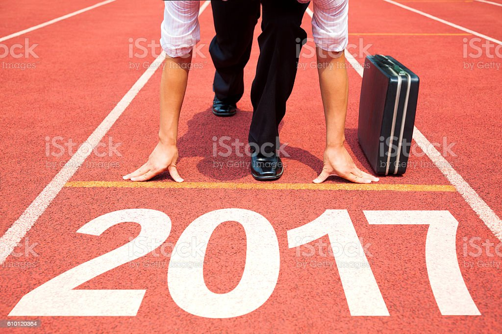 businessman ready to run and 2017 new year concept stock photo
