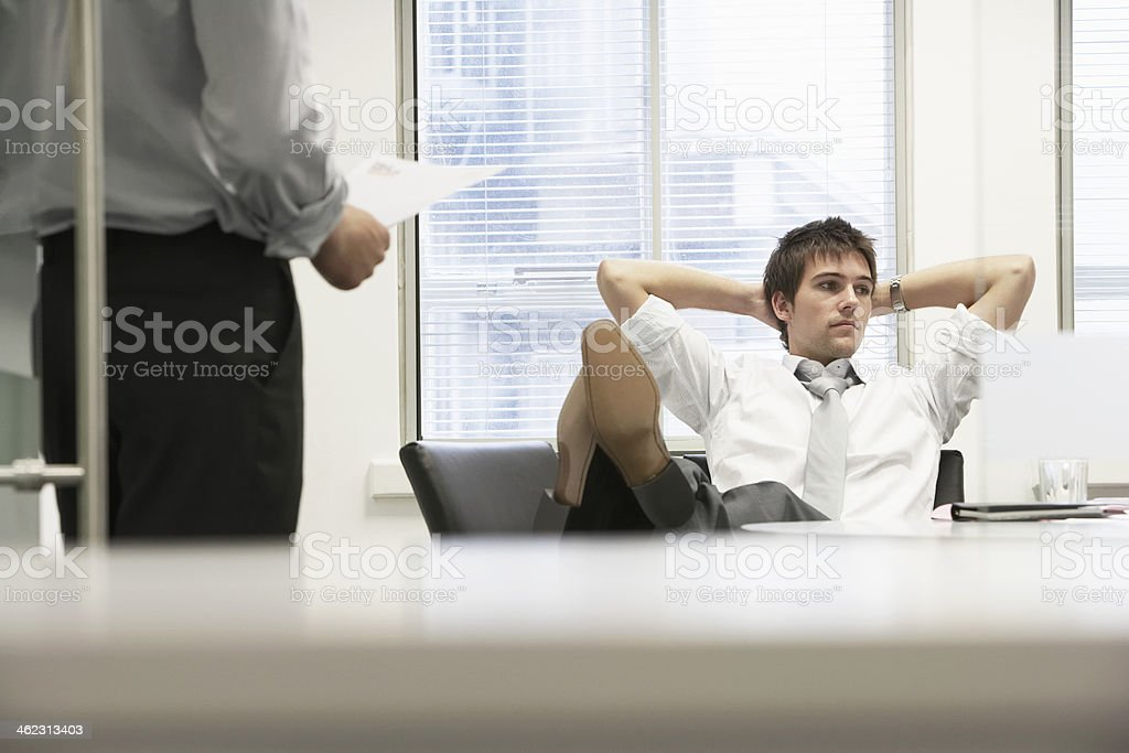 Businessman Reclining On Chair And Ignoring Boss stock photo