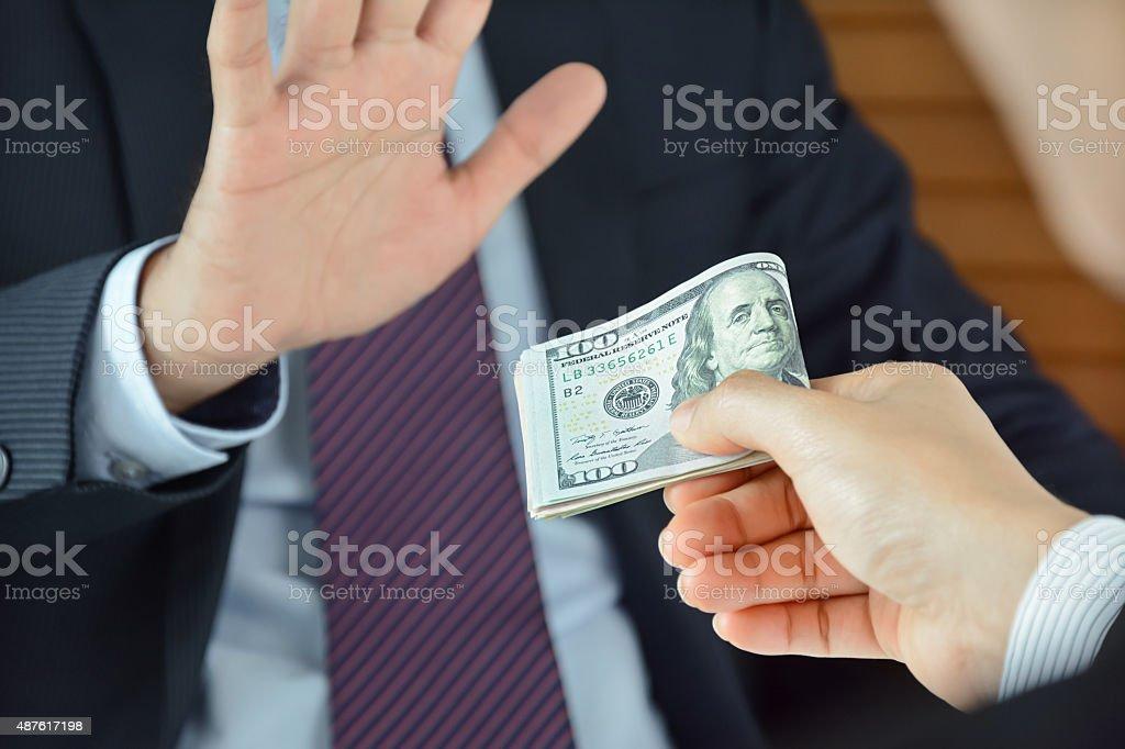 Businessman refusing money, uncorrupted concept stock photo