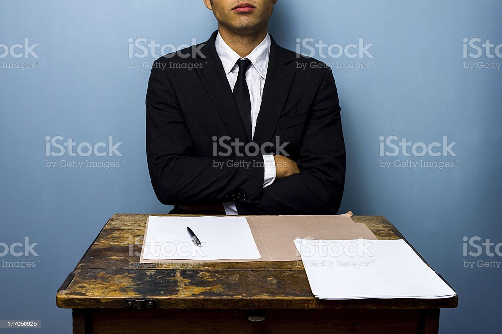 Businessman refusing to sign documents royalty-free stock photo