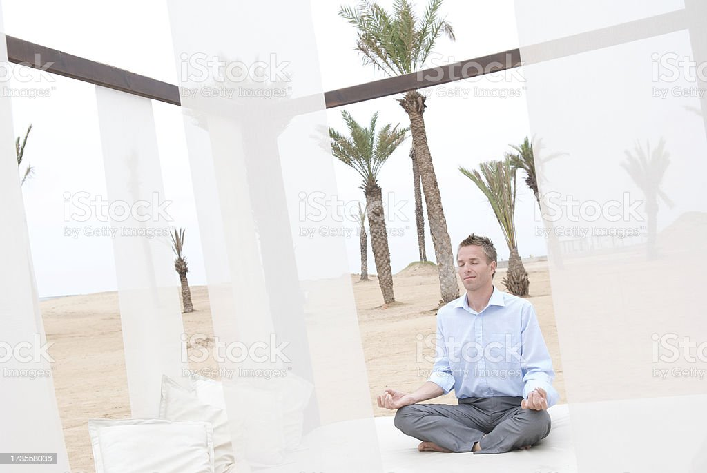 Businessman Relaxes in Desert Oasis of Calm stock photo