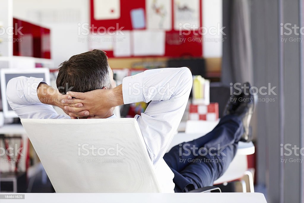 Businessman Relaxing at His Desk stock photo