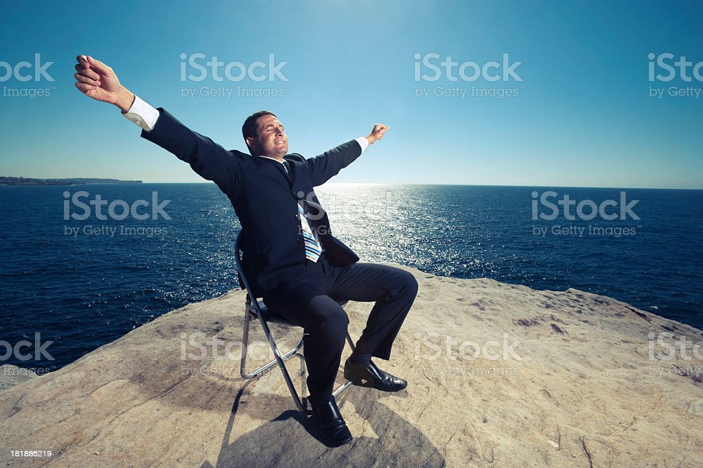 Businessman relaxing by the ocean stock photo