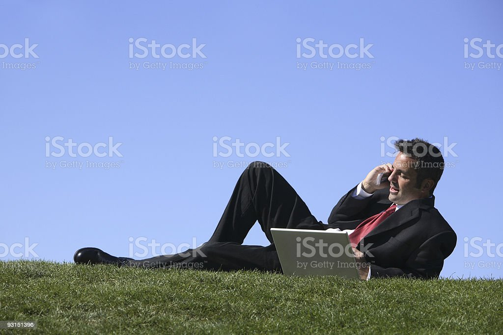 Businessman relaxing in grass royalty-free stock photo