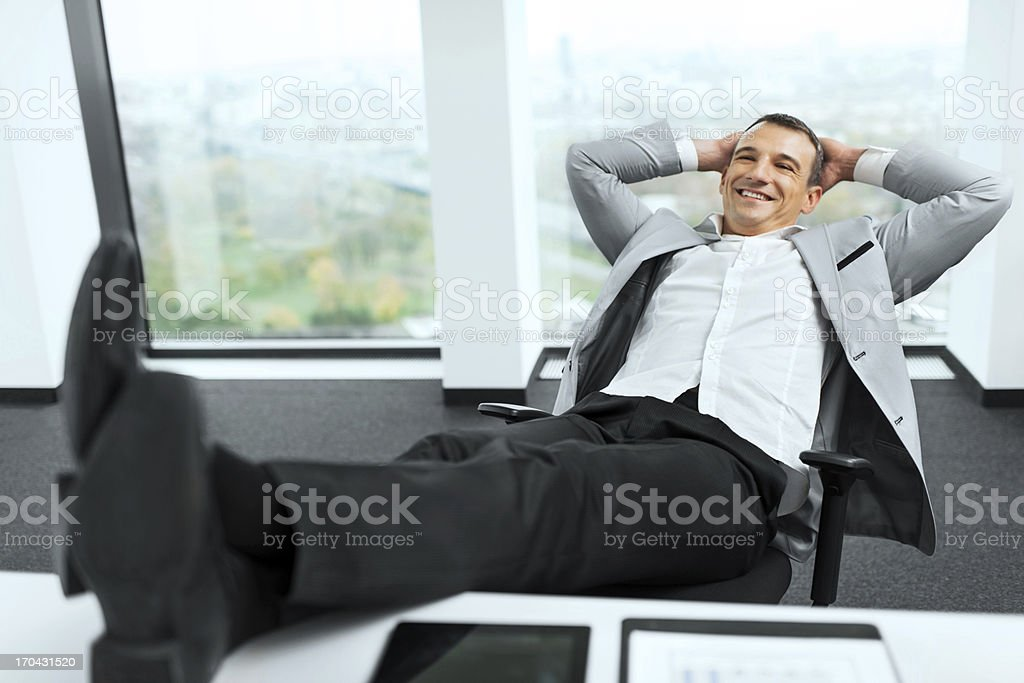 Businessman relaxing in his office. stock photo