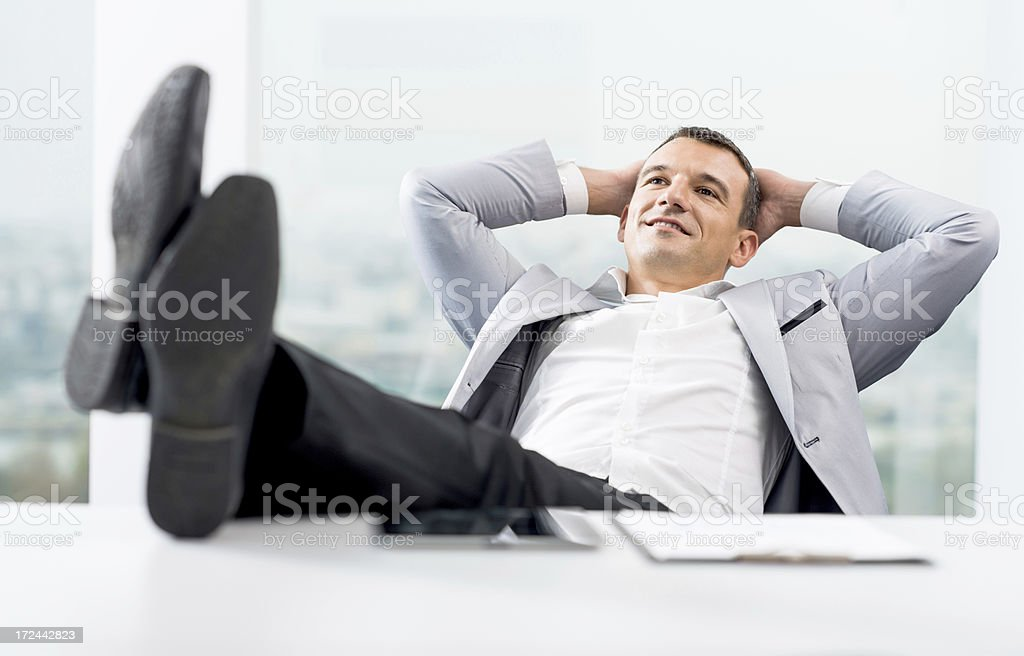 Businessman relaxing in his office. royalty-free stock photo