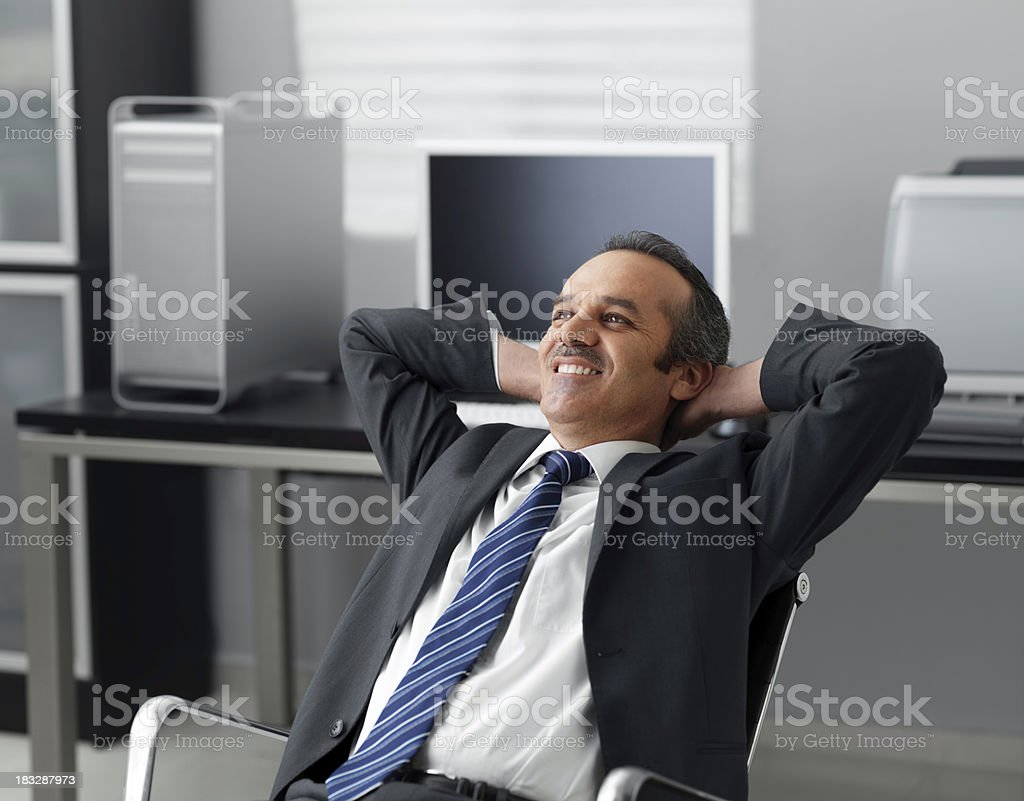 Businessman relaxing in his office royalty-free stock photo