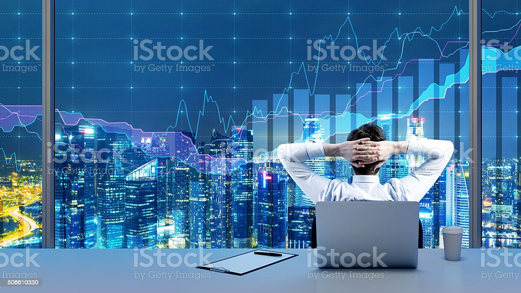 businessman relaxing in his office stock photo