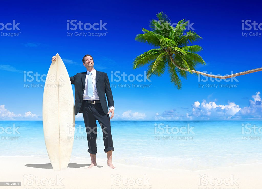 Businessman relaxing on the beach royalty-free stock photo