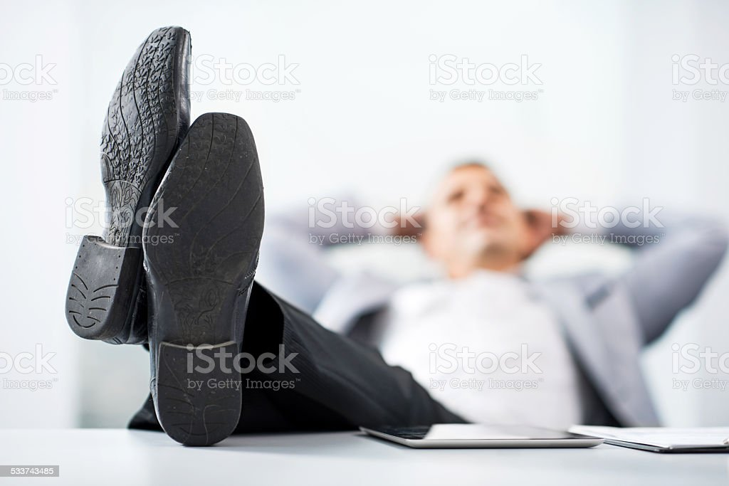 Businessman relaxing. stock photo
