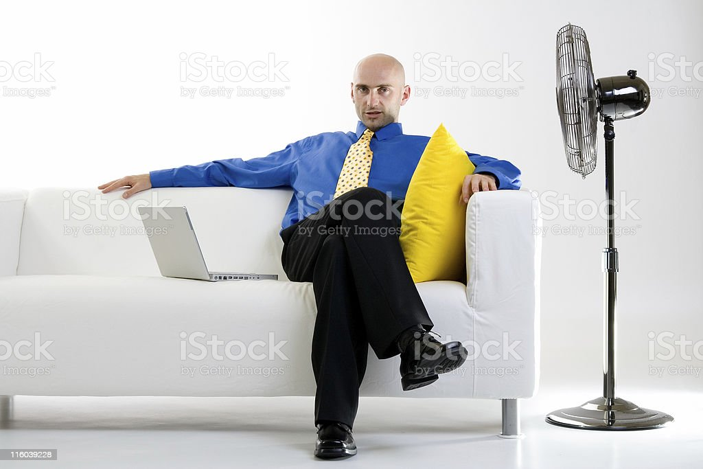 Businessman Relaxing With Fan royalty-free stock photo