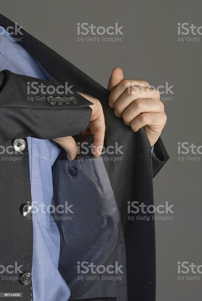 businessman removing wallet from jacket pocket royalty-free stock photo